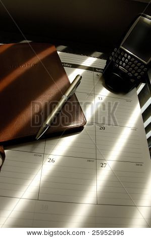 Businessman's Desktop With Planner, PDA And Journal Diary