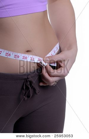 Young Woman With A Slim Waist Line And Measuring Tape