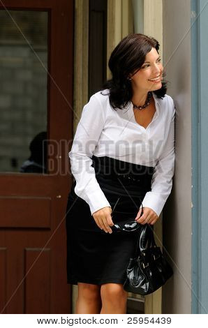 Pretty Woman Dressed In Business Wear Looking Out From A Doorway