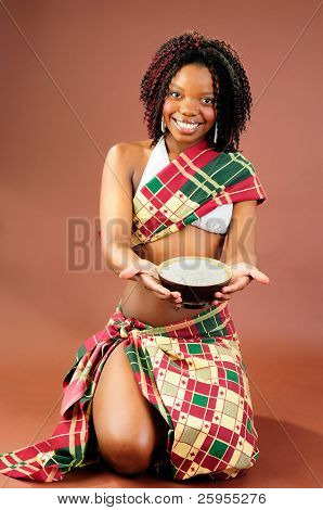 Beautiful African Young Woman Wearing Traditional Style Tribal Clothes Holding A Bowl Of Rice
