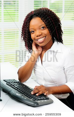 Beautiful Female African American Call Center Agent Wearing A Telephone Headset Using A Computer r