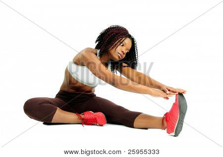 Beautiful African American Woman Dressed For Fitness At The Gym Stretching Before Exercise