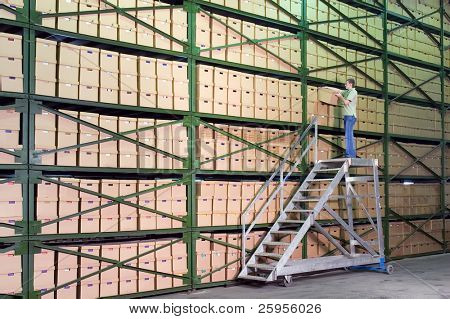 Man working on the stairs in the warehouse