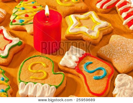 Santa's own cookies marked with an S, surrounded by colorful homemade Christmas cookie selection on wooden tabletop