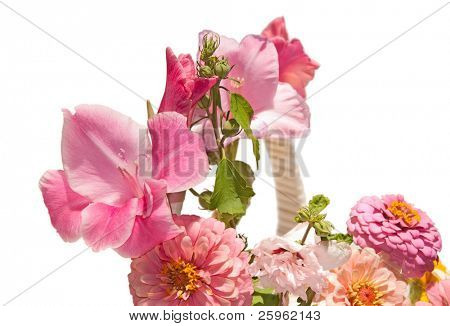 Closeup image of pink flowers in a basket, on white