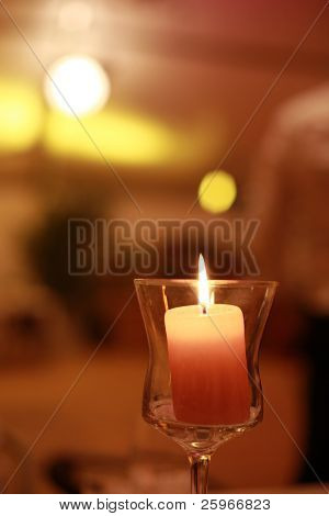 Romantic and mysterios scene - candlelight in glass
