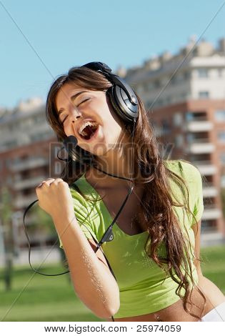 happy teenage girl in headphones