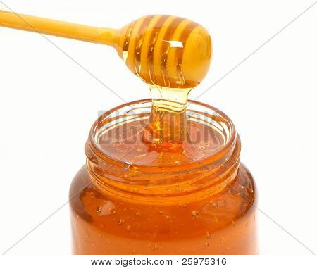 honey dripper and jar isolated on white background