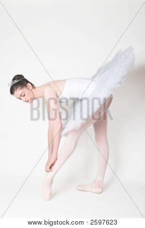 Ballerina Tying Her Shoe
