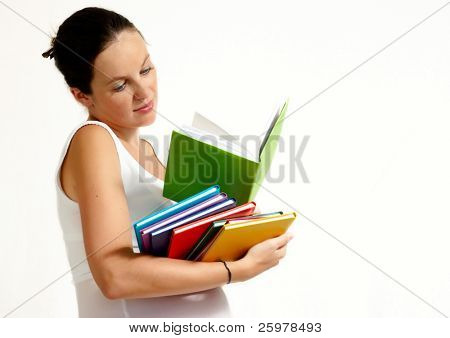 The pregnant woman with books on a light background
