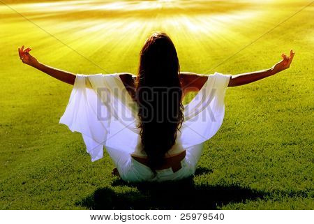 Meditation on a green field in solar beams