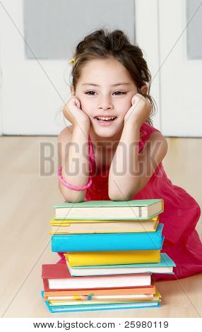 Portrait preschooler with book in kindergarten