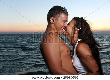 Closeup portrait of happy couple enjoying vacations