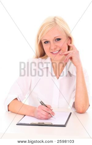 Businesswoman Sitting At Desk, Writing
