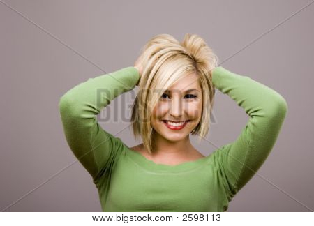 Blonde Mussing Hair Hands Behind Head