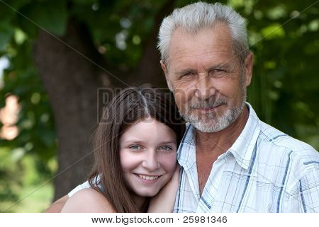 Portrait happy the grandfather and granddaughter outdoor
