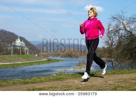 woman jogging in the park in summer
