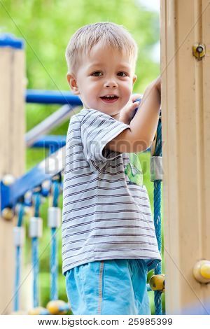 Little boy playing at playground