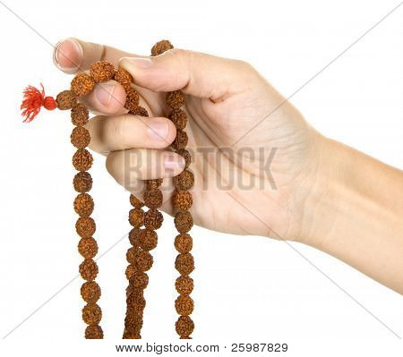 praying with a rosary, background is white
