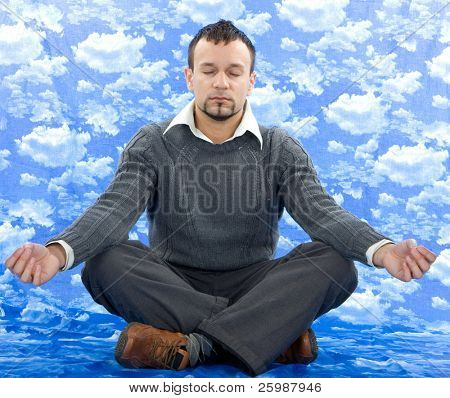 Businessman as yoga meditation isolated on sky background