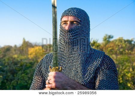 Knight warrior wearing armour and hold on a sword