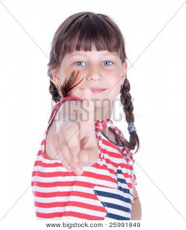 Cute little girl point her finger at someone, studio shot