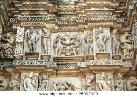 Fine figures of erotic scenes on the walls of western group of temples in Khajuraho, Madhya Pradesh, India