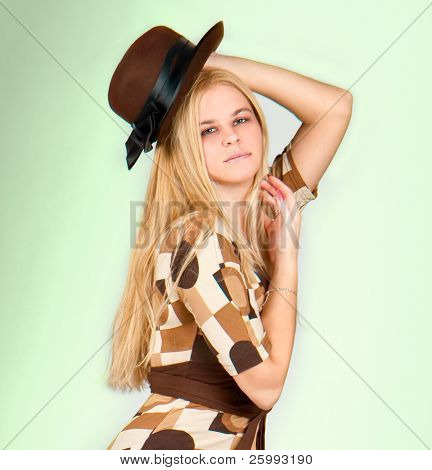 Beautiful fashion woman portrait with brown hat, close up