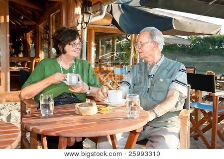Old couple enjoy in afternoon coffee, sunny day