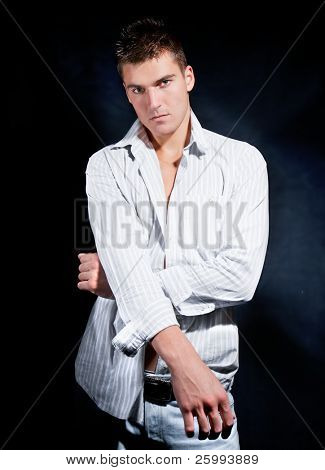 Fashion Shot of a Young Man. A trendy European man dressed in contemporary white shirt.