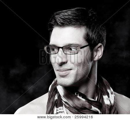 Black and white portrait of trendy attractive man who is smiling and he has glamorous look