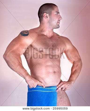 Muscular male model wrapped in a  blue towel