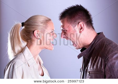Woman and man yelling at each other. Portrait fury couple. Face to face.