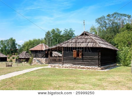 Traditional Timber ethno houses with Wooden Roof and stone base. Velika Plana. Eastern Europe - Serbia