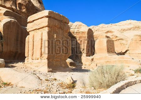 Djinn blocks, three enormous, squat monuments, standing guard beside the path, near the entrance, built by the Nabataeans in the 1st century AD. Ancient city of Petra, Jordan.