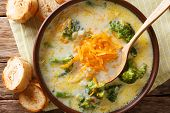 Broccoli Cheese Soup Served With Toasted Bread Close-up In A Bowl. Horizontal Top View poster