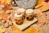Natural Homemade Treats Autumn Season Keep Healthy. Set Three Honey Natural Sweets In Jars Red Backg poster