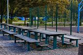 Tables For Rest In A Public Park. Outdoor Park Equipment. Rest Zone In The Park. City Park On A Summ poster