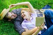 Couple Soulmates At Romantic Date. Couple In Love Spend Leisure Reading Book. Man And Girl Lay On Gr poster