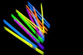 Colorful Fluorescent Light Neon Glow Stick On Mirror Reflection Black Background. Yellow Blue Pink O poster