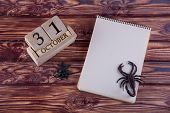 Top View On Blank Paper Notepad Laying On Wooden Table Near Spider, Scorpio And Cube Calendar With H poster