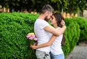 Man Fall In Love With Gorgeous Girl. Man Bearded Hipster Hugs Woman. Strong Romantic Feelings Become poster