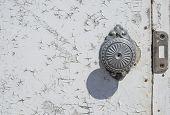 Rustic Door Knob. Cracked Paint. Old Door With Rust. Old Wooden Door Whith Door Knob. Ancient Doorha poster