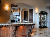 image of corbel  - lovely home bar made of wood with large corbels and granite counter top - JPG