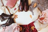 Set Of Seasonal Autumn Fashion Woman Clothes, Top View With Copy Space. Trendy Shoes, Sweater And Ha poster