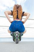 Back View Of Unrecognizable Woman Buttocks Wearing Short Blue Jeans Shorts And Roller Skates Enjoyin poster