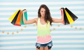 Strong Shopaholic Girl Hold Shopping Bags. Beautiful Shopaholic. Girl Holding Colorful Paper Bags In poster