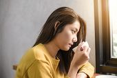 Close Up Of A Young Asian Woman Drinking Coffee In Coffee Shop Holding A Cup Of Coffee In Her Hand S poster