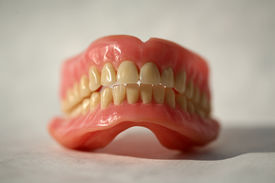 picture of false teeth  - Genuine Dentures AKA False Teeth from a Dentist Office on white - JPG