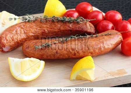 Sausages With Cherry Tomatoes, Lemon And Thyme
